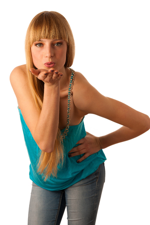Beautiful teenage girl sending a kiss isolated over white background photo