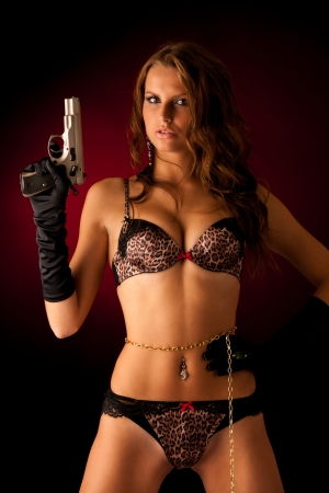 Beautiful lady in lingerie  with gun photo