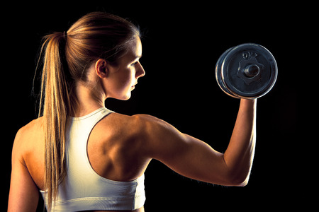 attractive young woman: attractive young woman working out with dumbbells