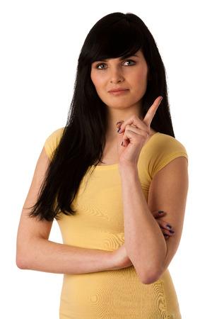 Beautiful young woman showing naughty sign photo