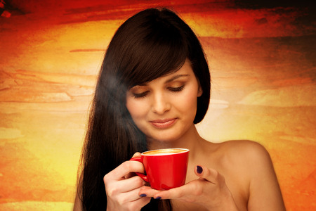 tive young woman with black hair holding red cup of coffee in her hand in the morning Stock Photo - 27331401