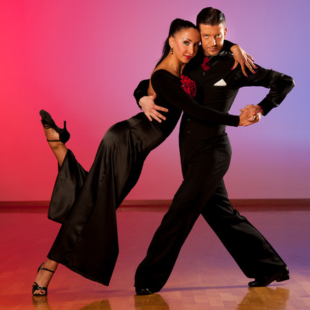 Professional ballroom dance couple preform an romantic exhibition dance photo