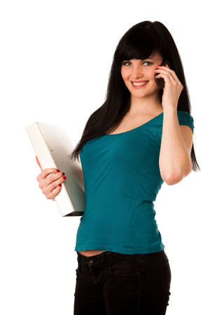woman student with schoolbag and folder talking on cellphone photo