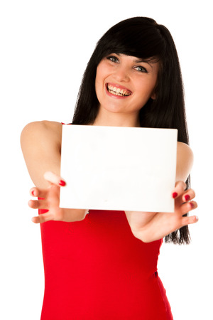 Excited beautiful young woman showing a blank paper isolated over white Stock Photo - 27331374