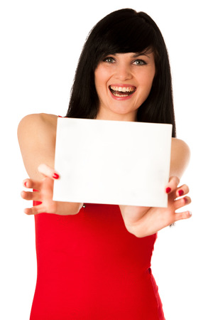 Excited beautiful young woman showing a blank paper isolated over white photo
