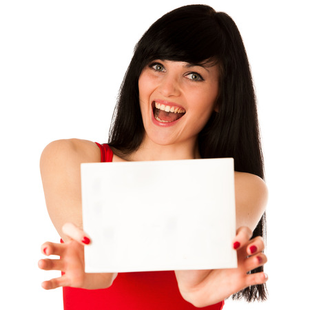 Excited beautiful young woman showing a blank paper isolated over white Stock Photo - 27311217