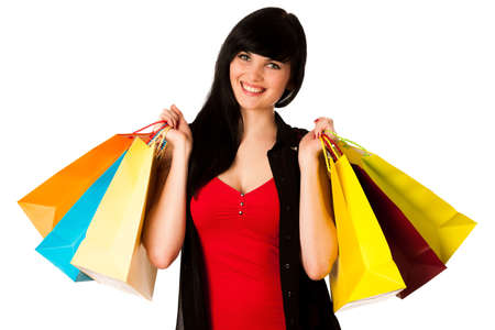 Beautiful young woman with shopping bags isolated over white photo