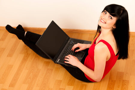 Young beautiful woman working on laptop photo