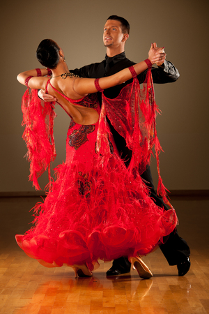 Professional ballroom dance couple preform an romantic exhibition dance