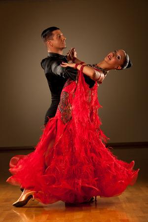 male dancer: Professional ballroom dance couple preform an romantic exhibition dance