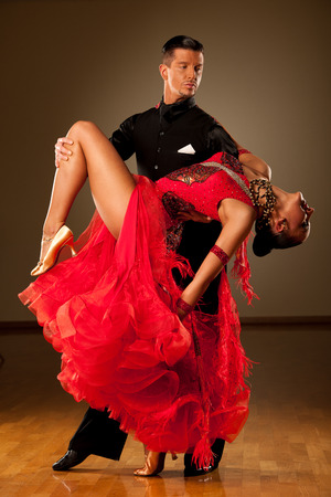 cha: Professional ballroom dance couple preform an romantic exhibition dance