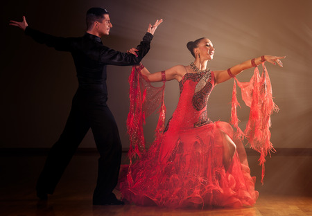 Professional ballroom dance couple preform an romantic exhibition dance