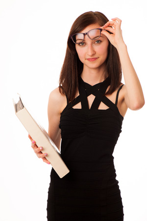 Young student with a folder in her hands isolated over white background photo