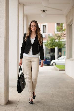 preety: Preety woman walking outdoor in the city