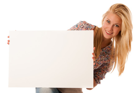 nde woman holding a blank white board in her hands for promotional text or banner isolated over white background photo