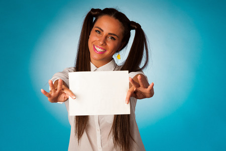 ful hispanic business woman holding blank card over blue background photo