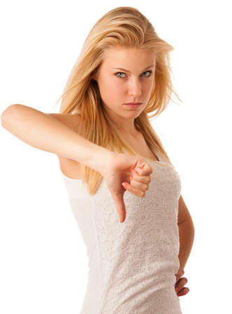 ange: Young blonde woman with blue eyes gesturing failure and ange with showing thumb down isolated over white background