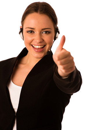 Preety happy asian caucasian business woman with headset showing thumb up as a gesture for success isolated photo