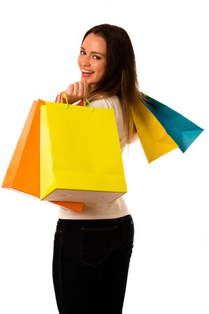 preety: Preety young woman with colorful shopping bags isolated over white background