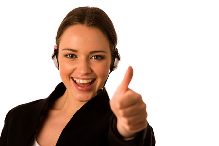 preety: Preety happy asian caucasian business woman with headset showing thumb up as a gesture for success isolated Stock Photo