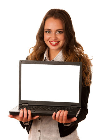 Attractive asian caucasian woman holding a laptop in her hands with blank space on monitor for adittional text isolated over white background photo