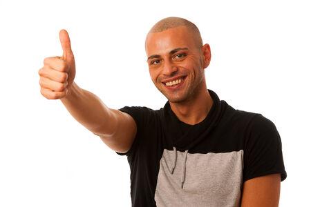 handsom: �xito del hombre joven Handsom gestos con el pulgar para arriba aislado sobre fondo blanco Foto de archivo