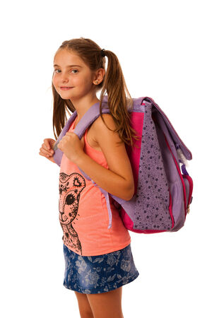 Young school girl with schoolbag isolated over white photo