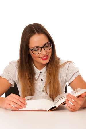 Happy asian caucasian girl study on the table isolated photo