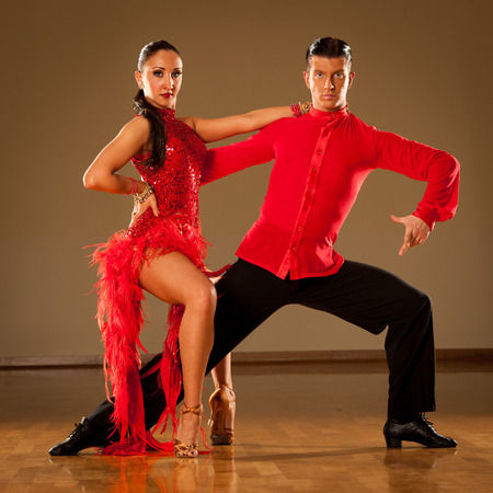 latino dance couple in action - dancing wild samba photo