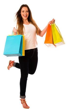 Preety young woman with colorful shopping bags isolated over white background photo