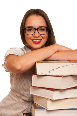 Happy asian caucasian girl with lots of books on the table isolated photo