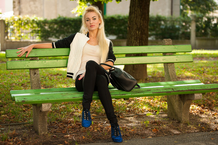 blond woman in park on late summer afternoon photo