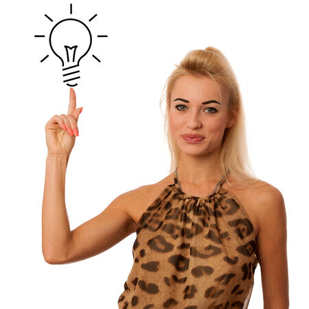 blonde woman pointing to light bulb isolated over white gesturing new idea photo