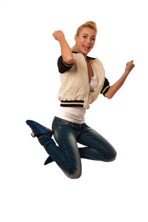 woman jumps over white gesturing success photo