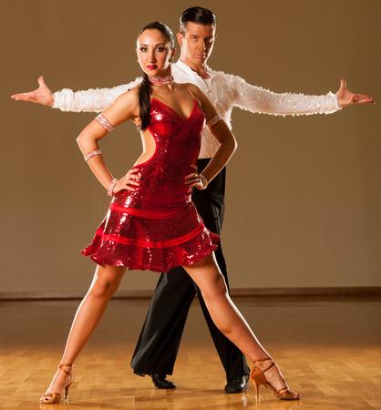 cha: latino dance couple in action - dancing wild samba Stock Photo