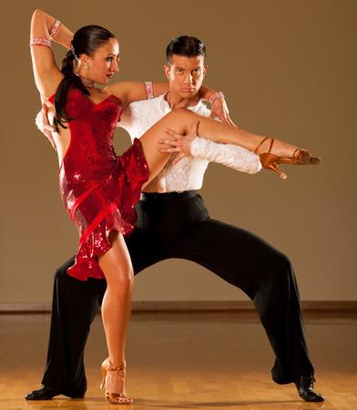 latino dance couple in action - dancing wild samba photo
