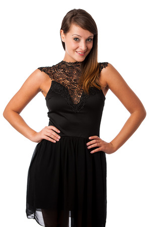 A stylish young brunette woman in black dress in little black dress with black accessories isolated photo