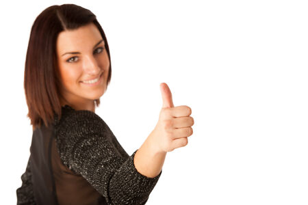 dressed for success: Beautiful young woman with brown hair dressed casual showing thumb up as a gersture for success isolated over white