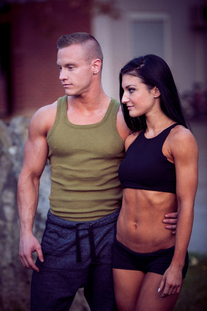Fitness couple on a street workout outdoors