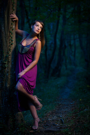 frightened Beautiful lady on a forest path photo
