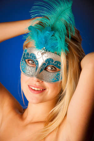 Cute blonde woman with venice mask on her face glamorous portrait on colorful background photo