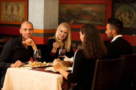 Young people eat dinner at restaurant photo