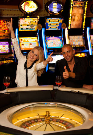 couple playing roulette in casino photo