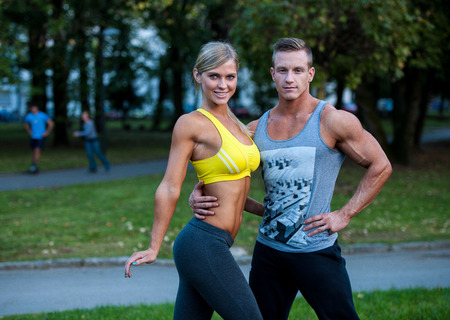 Fitness couple on a street workout outdoors Stock Photo