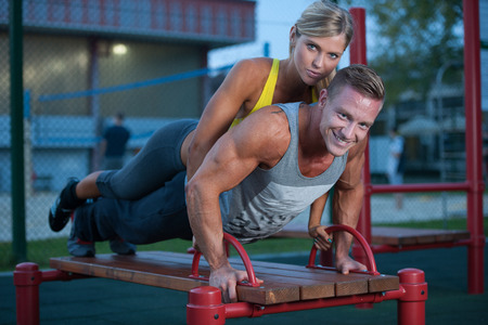 Fitness couple on a street workout outdoors photo