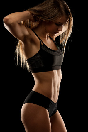 fitness abs female: attractive young woman working out with dumbbells - bikini fitness girl with healthy lifestyle and perfect body Stock Photo