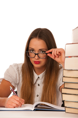 Stressed asian caucasian woman student learning in tons of books isolated Standard-Bild