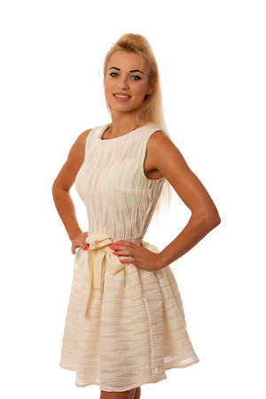 Beautiful young blonde woman posing isolated over white photo