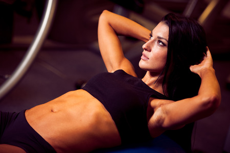 intervals: beautiful athletic woman working ab intervals