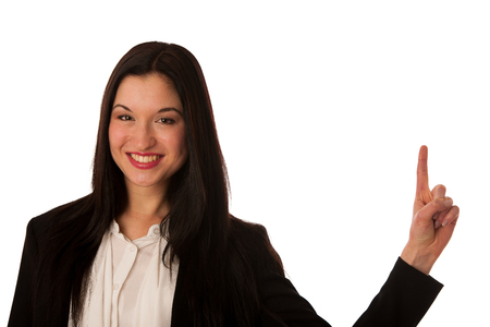sales person: Beautiful asian business woman pointing into copy space - sales person advertising a product isolated Stock Photo